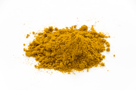 Curry powder isolated on white background Archivio Fotografico