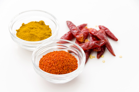 Cayenne pepper powder and Curry powder and Capsicum annuum in Stacking bowl isolated white background