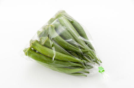 fresh okra in plastic bag isolated white background
