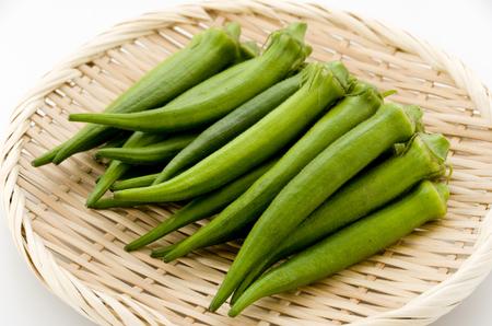 fresh okra on bamboo sieve Stock Photo