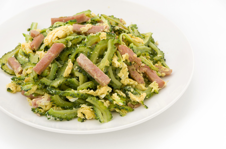 Goya Chanpuru is bitter melon stir-fried with pork and egg. Goya chanpuru is famously known as the local food of Okinawa, and is now eaten by people all over Japan.