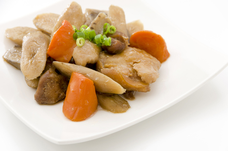 Japanese cuisine, Nimono, simmered root vegetables with chicken drumettes Foto de archivo