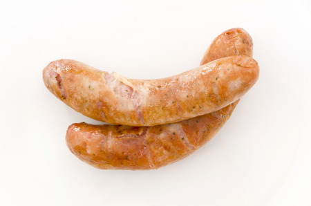 Delicious sausages on white background.
