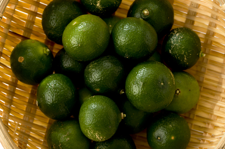 Thin-skinned flat lemon in sieve, Citrus depressa, Flat lemon, Hirami lemon