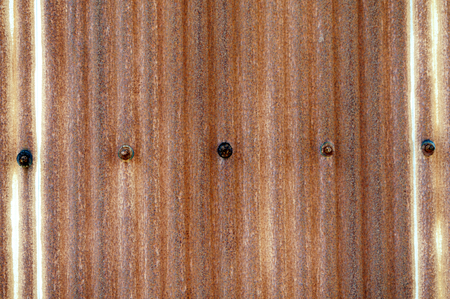 Rusty corrugated metal wall, rusty Zinc grunge background. Imagens