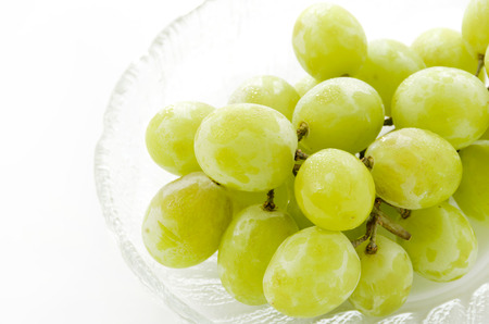 bunch of green Seedless Grapes on Glass dish