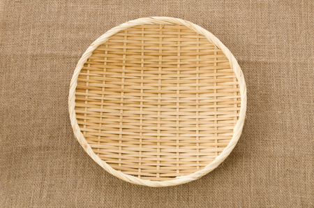bamboo Sieve on Burlap background 免版税图像 - 113699157
