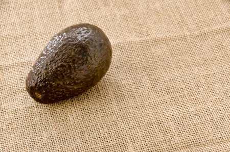 Avocado on burlap background