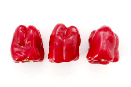 Three Red bell peppers isolated on white background Stock Photo