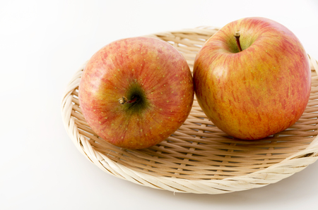 fresh apple on a bamboo colander Stock Photo