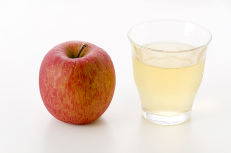 apple with glass of apple juice on white background