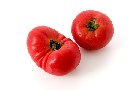 deformed tomato on white background
