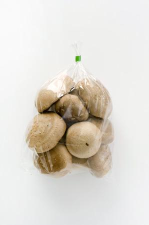 Shiitake mushroom in transparent plastic bag on White background