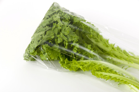 wasabi greens in a Plastic bag on white background Stock Photo