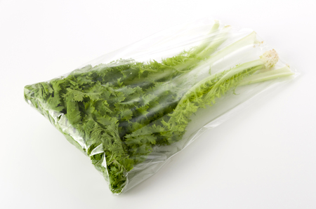 wasabi greens in a Plastic bag on white background