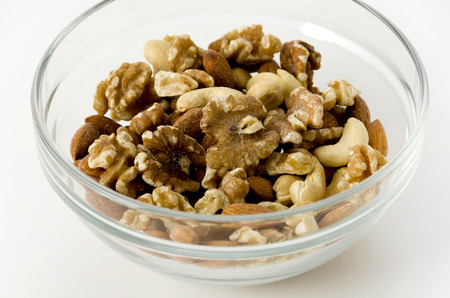 Mix of nuts in A Stacking bowl on A white background.