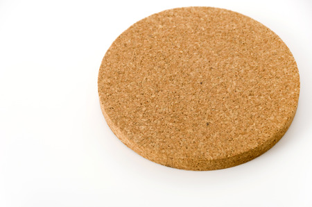 Cork coasters on white background