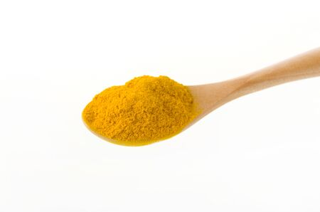 Turmeric (Curcuma) powder in wooden spoon on white background