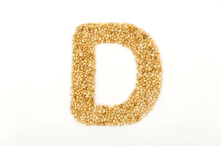 toasted sesame seeds letter D uppercase of English alphabet isolated on white background