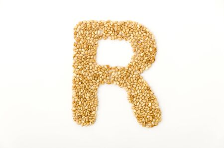 toasted sesame seeds letter R uppercase of English alphabet isolated on white background