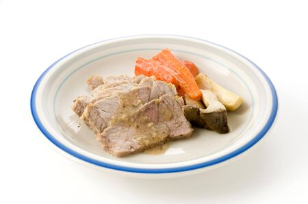 Roast pork with eryngii mushroom and Carrots on Plate on White background. Foto de archivo - 129859543