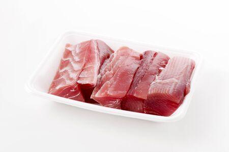 Maguro no ara Raw tuna fillet in the foam tray on White Background. 写真素材