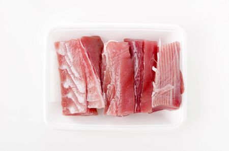Maguro no ara Raw tuna fillet in the foam tray on White Background. Фото со стока