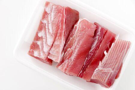 Maguro no ara Raw tuna fillet in the foam tray on White Background. Zdjęcie Seryjne