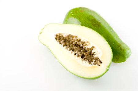 Halved and whole papaya fruits on white background Reklamní fotografie