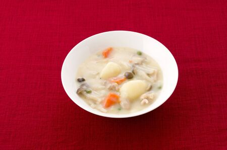 Japanese food, Cream stew on red cloth background 스톡 콘텐츠