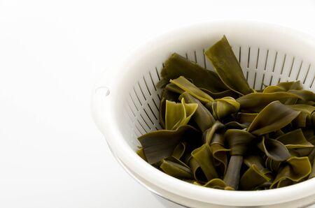MusubiKombu, Kombu Kelp is a large brown algae seaweed.  It is an edible seaweed used extensiveinly in Japanese cuisine.