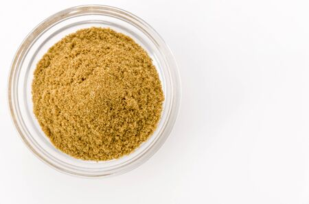 Cumin Powder in Small transparent bowl on White Background
