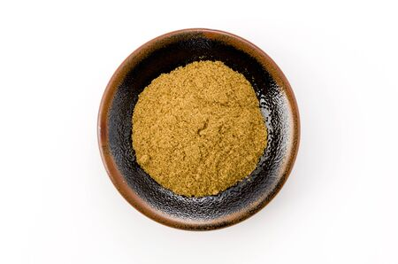 Cumin Powder in Small black dish on White Background