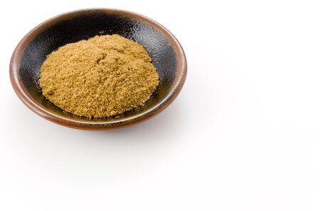 Cumin Powder in Small black dish on White Background