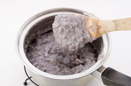 Japanese food, Okinawa cuisine, Ta-nmu(Taimo) ringaku, Boil the Taimo and peel it, it, add sugar and knead. Stock Photo