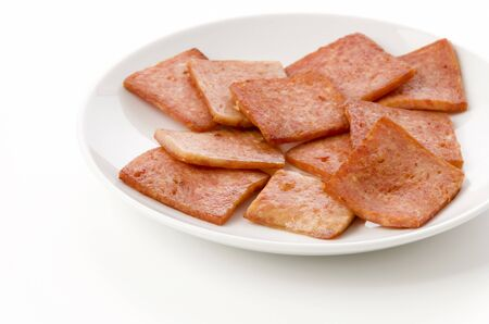 pan fried luncheon meat on white plate