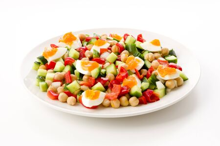 salad of chickpeas with vegetables and boiled egg