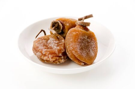 Dried persimmon on a plate Imagens