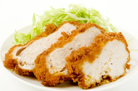 breaded chicken with Shredded Cabbage on a white dish on white background