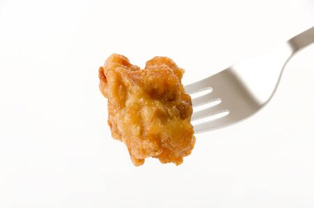 Japanese food, tori karaage, Fried chicken on a fork on white background 版權商用圖片