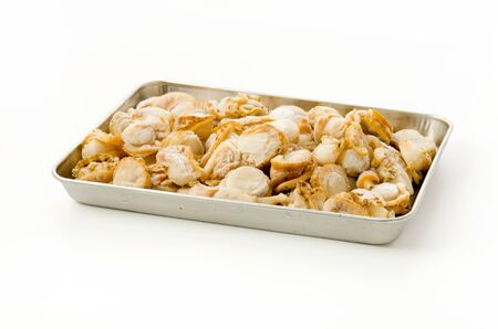 frozen seafood scallop meat on a Stainless Steel tray on white background