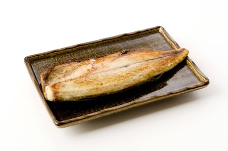 Grilled mackerel on a Square plate on white background