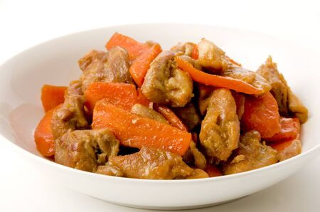Chicken Fry Stir with carrot in the white dish on white background.