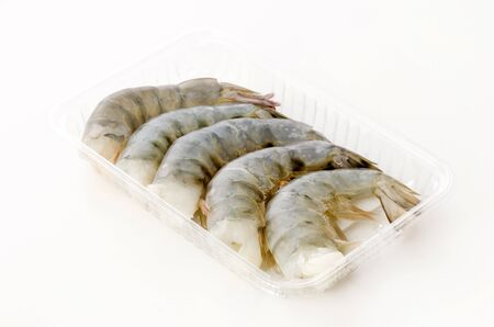 Fresh black tiger shrimp tails in plastic pack on white background Stok Fotoğraf
