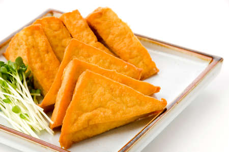 Thick fried tofu with white radish sprouts Stockfoto