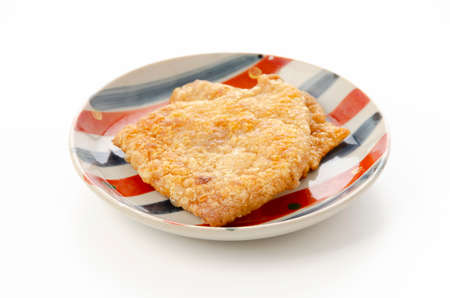 Crispy Fried Chicken Skins on Plate 版權商用圖片 - 161398055