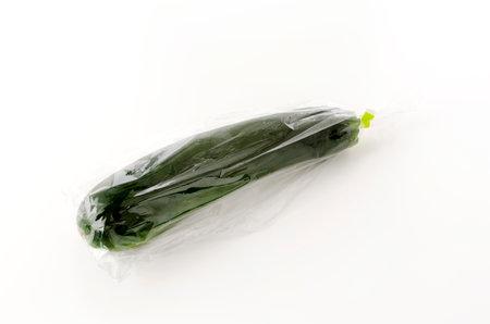 fresh raw zucchini in Plastic bag on white background