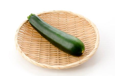 fresh raw zucchini on a bamboo sieve on white background 版權商用圖片 - 161252561