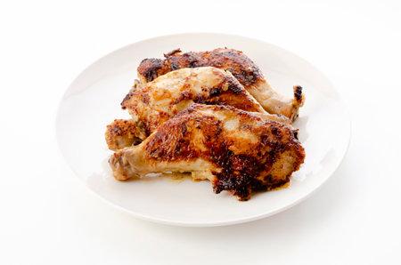 Roasted chicken leg on a white background 版權商用圖片