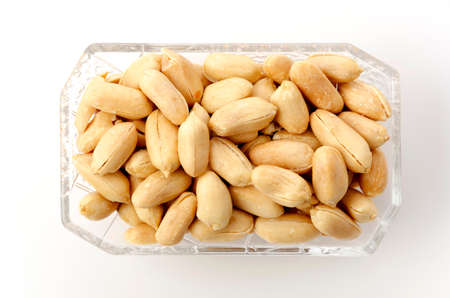Roasted salted peanuts in a small square glass plate on a white background 版權商用圖片 - 161823926